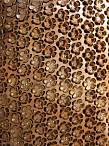 Flower shapes cut by laser, metallic nailheads as decoration. Wool fabric basics